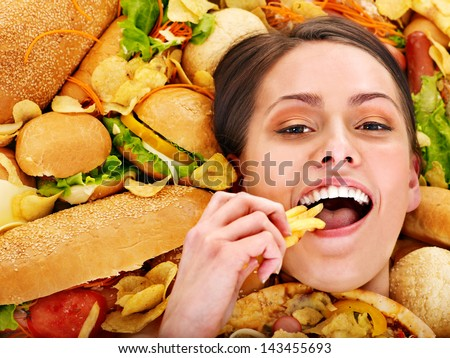 Thin woman holding hamburger. - stock photo