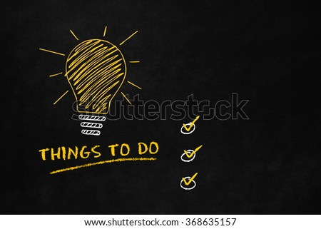 "Things to do concept with a Lightbulb on a blackboard, A big yellow bulb with 6 smaller light bulbs and text ""Things to do"", Conceptual symbol for ""to do"" list - stock photo"