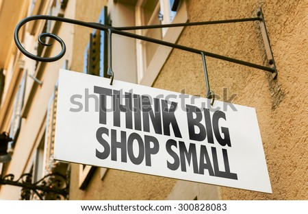 Think Big Shop Small sign in a conceptual image - stock photo