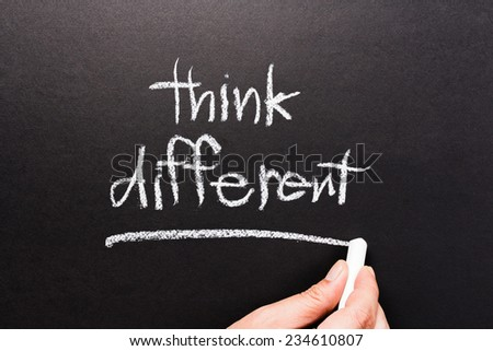 Think Different, handwriting on chalkboard - stock photo