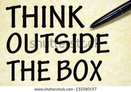 think outside the box title written with pen on paper - stock photo