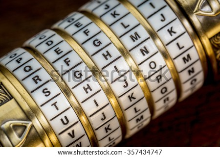think word as a password to combination puzzle box with rings of letters - stock photo