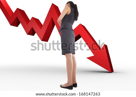 Thinking asian businesswoman against red arrow pointing down - stock photo