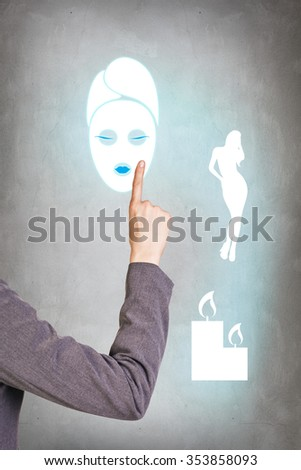 Thinking business woman on gray background with finger at face - stock photo