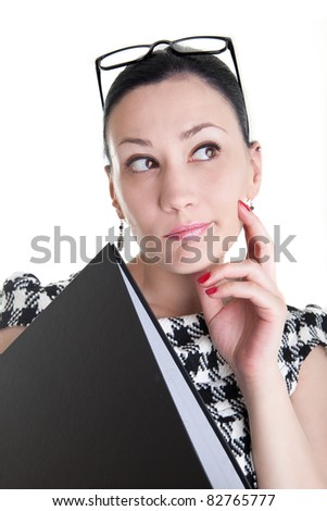 Thinking business woman with glasses on her head - stock photo