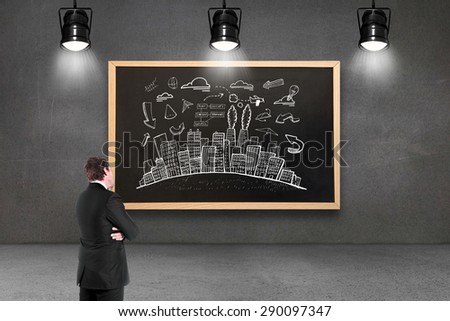 Thinking businessman against blackboard with copy space - stock photo