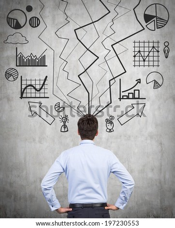 Thinking businessman, and wall sketches. - stock photo