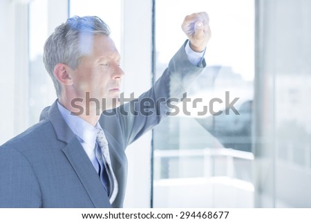 Thinking businessman in the office - stock photo
