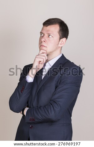 thinking businessmen in blue jacket looking up left - stock photo