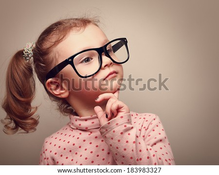 Thinking cute kid girl looking. Instagram effect portrait - stock photo