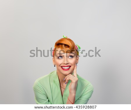 Thinking, daydreaming. Closeup portrait headshot thoughtful cute woman looking up isolated grey gray wall background copy space above head. Human face expressions, emotions, feelings body language - stock photo