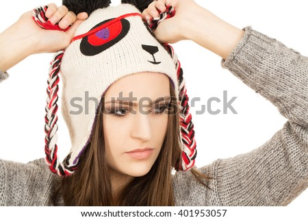 Thinking deep. Close up shot of a cute hipster female wearing panda hat looking at the copyspace. - stock photo