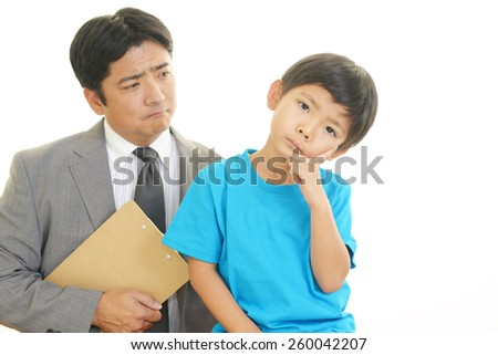 Thinking father and son - stock photo