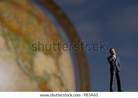 Thinking globally, Business figure in front of globe with clouds in background - stock photo