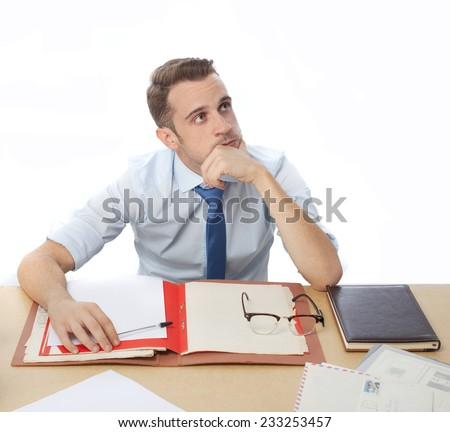 thinking man in office desk  - stock photo