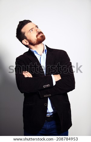 Thinking man isolated. Closeup portrait of a casual young pensive businessman looking up at copyspace. Caucasian male model.  - stock photo