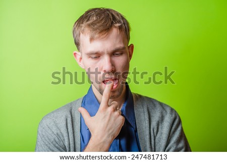 thinking man with beard  finger in mouth - stock photo
