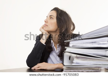 Thinking of holidays during overtime hours - stock photo