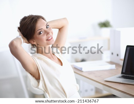Thinking office worker day dreaming looking up smiling - stock photo