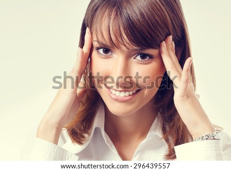 thinking or planning young businesswoman in white business style clothing, looking at camera - stock photo