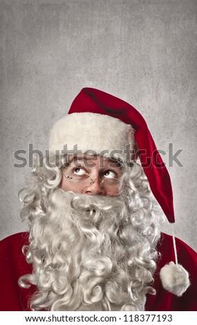 Thinking Santa Claus - stock photo
