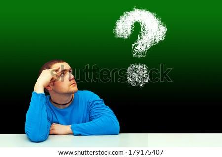 thinking symbol of young man - stock photo