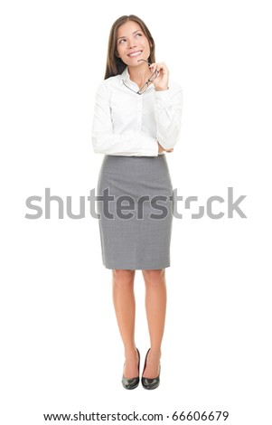 Thinking woman in white shirt happy pensive looking up at copy space. Isolated over white background. Mixed race Caucasian white / Chinese Asian. - stock photo