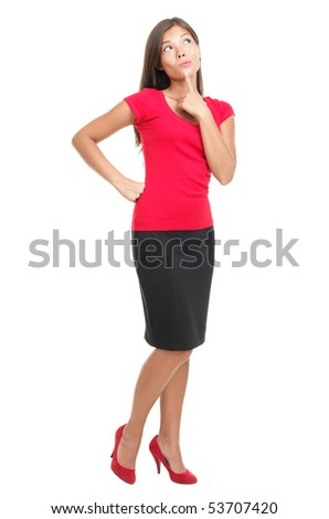 Thinking woman isolated on white background in full body / length. Beautiful young mixed race Asian / Caucasian business woman being pensive looking up - stock photo