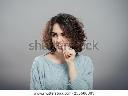 Thinking woman pondering over something - stock photo