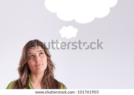 Thinking woman with thought bubble with copy space - stock photo