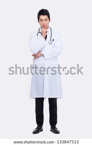 thinking Young Asian doctor isolated on white background. - stock photo