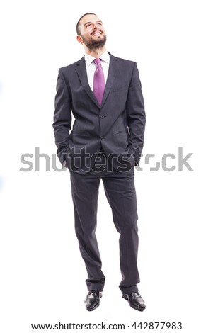 Thinking young businessman standing on white background - stock photo