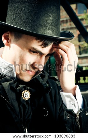 thinking young gentleman - stock photo