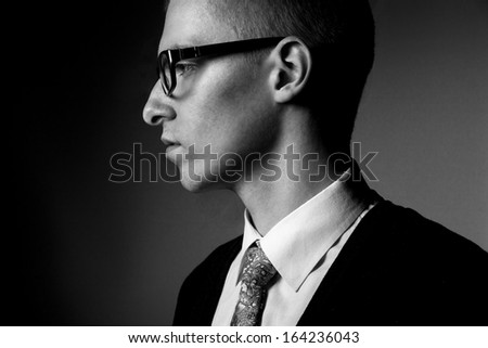 thinking young man profile bw portrait - stock photo