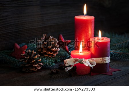 third advent with candles and decoration  - stock photo