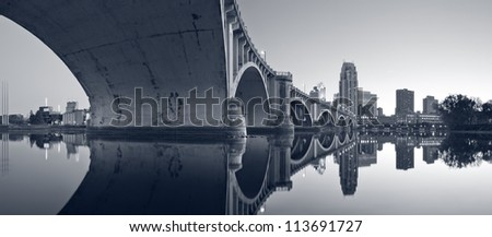 Third Avenue Bridge Minneapolis.Toned image of Third Avenue Bridge, originally known as the St. Anthony Falls Bridge in Minneapolis, Minnesota. - stock photo