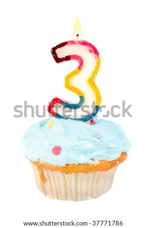 third birthday cupcake with blue frosting on a white background - stock photo