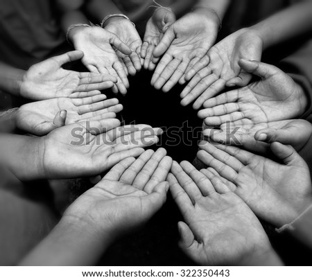 Third world kid hands round praying for god present to lift up their life - stock photo