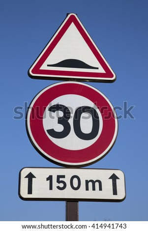 Thirty Speed Sign against Blue Sky Background - stock photo