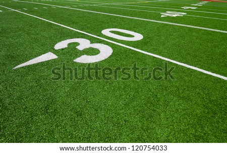 thirty yard line - football field - stock photo