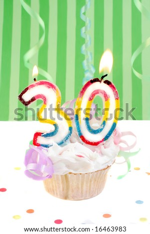 thirtyeth birthday cupcake with white frosting and green decorative background - stock photo