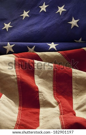 This American flag, popularly attributed to Betsy Ross, was designed during the American Revolutionary War features 13 stars to represent the original 13 colonies.  - stock photo