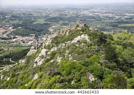 This ancient hill fortress in Portugal was first built in the 9th century and has been reconstructed several times to provide protection for the town of Sintra below. - stock photo