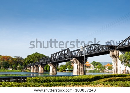 This bridge was a huge ladmark from world war II. Thousands of prisoners of war were driven in unimaginable conditions by the Japanese to build this railway from Burma to Thailand. - stock photo