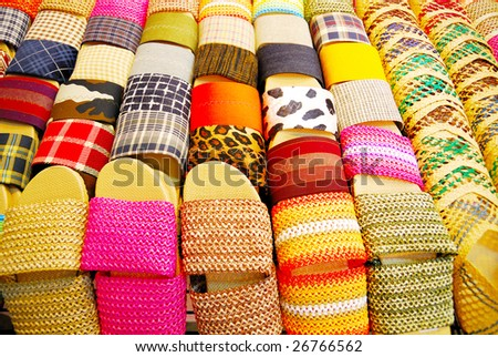 This colorful shot was generated by numerous slippers with their vivid colors. - stock photo