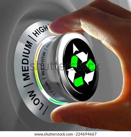 This concept illustration shows a button with three levels of recycling and fingers maximizing it. - stock photo
