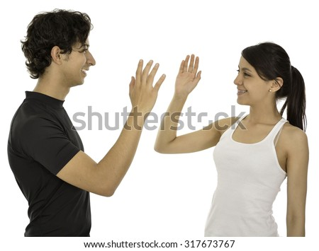 This couple hi five and smile they have a sport clothes. - stock photo