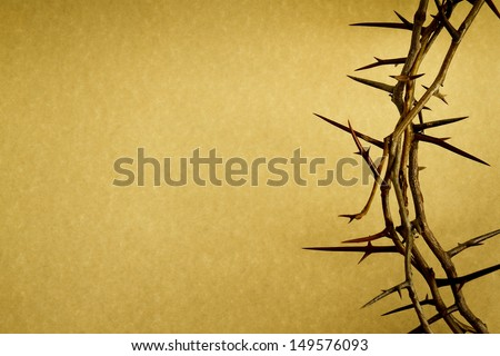 This Crown of Thorns against parchment paper represents Jesus's Crucifixion on the Cross, dying and then rising on Easter Sunday.  - stock photo