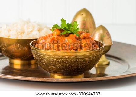 This East Indian dish consists of chick peas, tomato and onions in a spicy sauce. - stock photo
