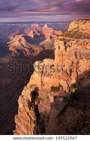 This file of a majestic sunset photo at the South Rim of the Grand Canyon captures the amazing layers of landscape and quality of light - stock photo